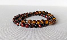 Check out this item in my Etsy shop https://www.etsy.com/ca/listing/513805423/red-tigers-eye-bracelet-chakra-bracelet