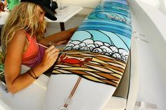 Heather Brown painting a board