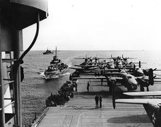 USS Hornet and escorts with B-25 Mitchell bombers sailing towords their epic raid.