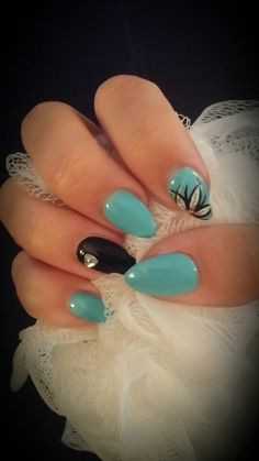 My baby blue & black almond nails.