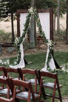 Wedding Arbor with eucalyptus garland and flowers #weddings #weddingcolors #weddingideas #springwedding #himisspuff #neutral #greenery #greeneryweddings