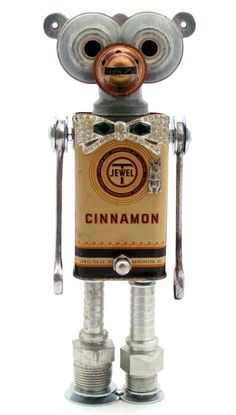 """Cinnamonkeybuns"" Height: 10"" Principal Components: Sprinkler head, oil lamp burner, spice tin, wrenches, hose fittings, jewelry, erector set girder (tail)"