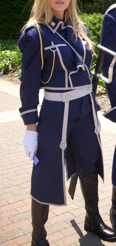 Fullmetal Alchemist FMA military officer anime by QualityCosplay<<< I think that's a General Armstrong cosplay.