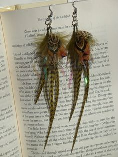 Shimmer of Earth Pheasant feather earrings by Bunneycrafts on Etsy, $9.50