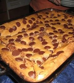 Ooey gooey chocolate chip cake. Not for the faint of heart: uses a yellow cake mix, a stick of butter, a full 16oz of confectioners sugar, and more. Maybe a once-in-a-decade type indulgence.