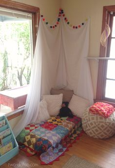 A cozy reading corner in a 1930's home-turned-preschool classroom!
