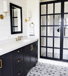 Love the floor tiles and navy  vanity with white top