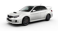 Subaru Impreza WRX STI. I want this car...just either blue or black...or both.