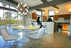 I love open spaces with a lot of light. Mid-century homes with vaulted ceilings and large windows.