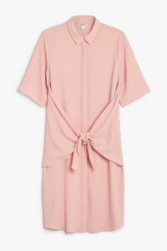 Though the shirt dress may be familiar, this one has some unique stuff going on. Namely, there's a panel in the back that you can leave hanging hang for a floaty cape look ooorrrrr you can tie it round front. colour: pink deco In a size small the chest width is 108 cm and the length is 103 cm. The model is 170 cm and is wearing a size small.