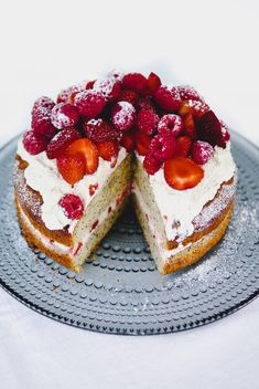 Easy recipe for gluten free lemon poppy seed cake with strawberry cream and fresh berries. The perfect gluten free summer cake.