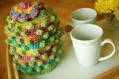 Olympic Coffee Cozy | On a small elf head, this cozy could easily pass for a whimsical hat. This cozy will keep a two-cup pot toasty warm. Free PDF download.