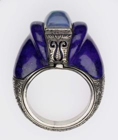 Ring -  silver with lapis stones and opalescent stone in center. Possibly Russian - 1900's