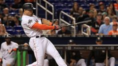 Giancarlo Stanton homered off the retaining wall behind the center field fence, a shot estimated at 460 feet, and the Miami Marlins beat the Los Angeles Angels 8-5 on Friday night.