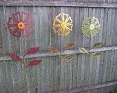 Metal Flower Yard Garden Art, I can see using water tap knobs to make these!
