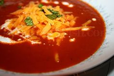 Homemade tomato soup made with fresh summer tomatoes - absolutely delicious! Take it from someone who doesn't normally like tomato soup.