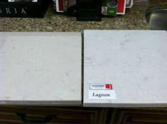 """Island countertop choices - Caesarstone Misty Carrara is on the left and is a little bit creamier with less marbling. Silestone Lagoon is on the right and is a little bit lighter and grayer with more """"veining"""""""