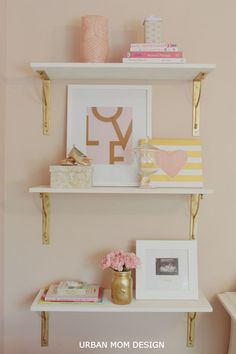 peach & gold nursery with gold painted shelf brackets // nursery room