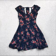 Navy Blue Abercrombie Skater Dress This was one of my favorite dresses, but sadly it's too small for me! Still in amazing condition! It is a skater style dress with two cutouts in the back. Abercrombie & Fitch Dresses