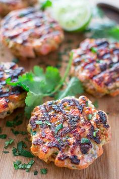 This tasty and easy Salmon Burger recipe is not to be missed! Ditch the bun and serve it with mouthwatering Avocado Salsa. @cooktoria