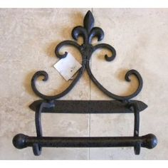Wrought iron on pinterest wrought iron plate racks and candle holders - Fleur de lis toilet paper holder ...