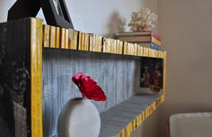 shelf made from national geographic magazines...need to start collecting magazines