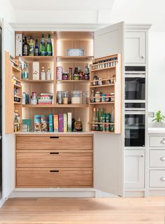 The 'must have' cabinet - a larder cupboard. A brilliant way to maximise storage space and it's so easy to see all of your dry foods, oils and spices all in one place. We love making these. Kitchen Pantry Cupboard, Kitchen Pantry Design, Kitchen Cabinetry, Kitchen Storage, Kitchen Sofa, Food Storage, White Wood Kitchens, Cool Kitchens, Modern Kitchen Lighting