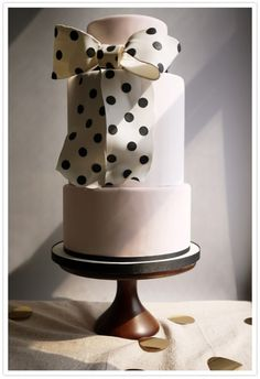 modern wedding cake with polka-dot bow.. SO in love with this cake!!