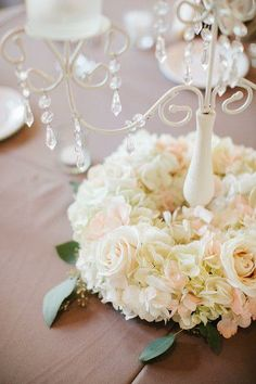 Love the hanging crystals on these centerpieces