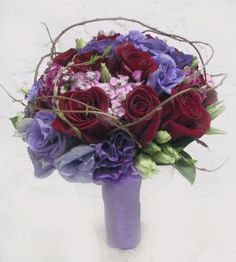Red Rose, Purple Eustoma, Sweet Willium & greens with twigs. Love the look the added twigs gives the bouquet.