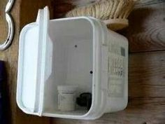 Great idea...nail empty supplement tubs to the walll for a small cabinet