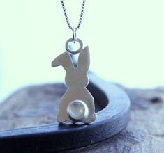 A personal favorite from my Etsy shop https://www.etsy.com/listing/519469451/sterling-silver-bunny-charm-necklace