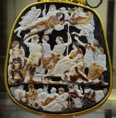 The Great Cameo of France is a five-layered sardonyx cameo divided into three levels which depicts members of the Julio-Claudian dynasty, circa 23 CE.  The Great Cameo of France is the largest cameo to survive from the ancient world. It contains 24 engraved figures. The dead are placed in the upper part, while the middle register represents the world of the living.  Tiberius in the center of the cameo sits on his throne, along with his mother and the wife of Augustus. (Photo by Carole…