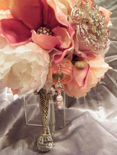 """Introducing """"The Sareh"""" another stellar bouquet by Crystal Brooch Bouquets Inc. This bouquet was named after """"Sareh Nouri"""" the fabulous wedding gown designer! If you are in Jersey stop by and see the salon and our brooch bouquets! Brooch Bouquets, Bride Bouquets, Brooches, Our Wedding, Dream Wedding, Wedding Decor, Designer Wedding Gowns, Gown Designer, Creative Wedding Ideas"""