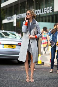 Loving Olivia's grey coat with the pop of orange.