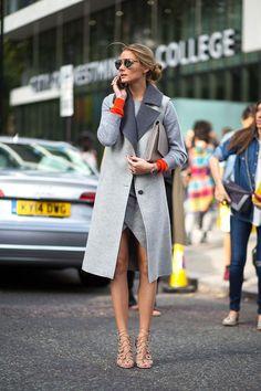 Loving Olivia's grey coat with the pop of orange.