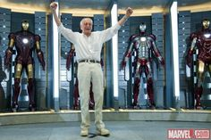 Stan Lee and the wall of Iron Man armor.  There is far too much awesome happening.