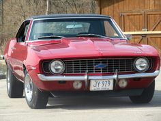 1969 Camaro, red convertible... This has been my dream car for as long as I can rememeber. :'D