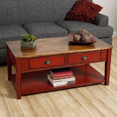 @Overstock.com - Cape Red Coffee Table (Indonesia) - This beautiful coffee table is hand-made in Indonesia with a distressed, antique-look finish. This beautiful table has two drawers and a lower shelf for excellent storage capacity.  http://www.overstock.com/Worldstock-Fair-Trade/Cape-Red-Coffee-Table-Indonesia/7327366/product.html?CID=214117 $339.99