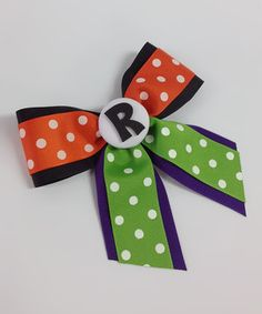Darling divas will go positively dotty over this personalized bow! Classic ribbon is carefully looped, topped with a playful initial accent and nestled on a sturdy alligator clip for a perfectly pretty piece.