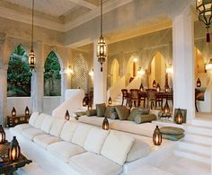 Look at this gorgeous Moroccan setting. No couch frames at all, just cushions on pure stone. An interesting living/dinning room.