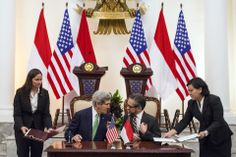 Oscar Siagian/Getty Images SIGNING CEREMONY: Indonesian Foreign Minister Marty Natalegawa, right, and U.S. Secretary of State John Kerry signed an MOU on cooperation on wildlife trafficking Monday in Jakarta, Indonesia.