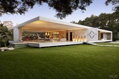 Inspired by the renowned Farnsworth house designed by modernist architect Mies van der Rohe, this house is a floating glass pavilion showcasing minimalism on a grand scale. The house features a long, low roof that cantilevers 55ft in two directions. Butt-jointed glass walls provide uninterrupted views of the picturesque oak woodland areas on the 4-acre site.