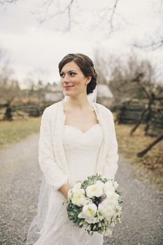 Beautiful bride in a winter white sweater and dress