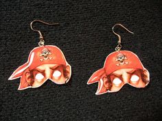 Pirate Jim! He wears a loop earring. Price: 8€ / ₤6.5 (+ ₤1.50 for postage in UK).