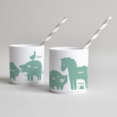 Buddy and Bear white hard plastic drinking vessel with animal print in green as children's tableware, toothpaste cups or for picnics.