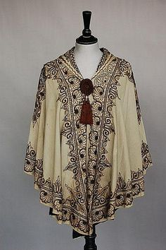 together with cream wool cape trimmed with soutache braid and tassels c.1910