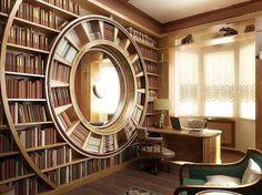 Оригинальный книжный шкаф с круглой полкой посередине.