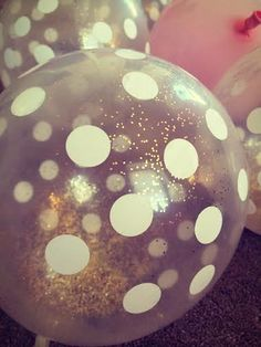 These glittery balloons add the perfect touch of sparkle. All I did was funnel some gold glitter into them before blowing them up.