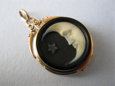 "An antique detailed and charming ""man in the moon"" pendant locket that is from the Victorian era."